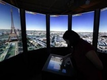 Katharine Ng zooms in to Paris on panoramic Google Maps screens at the Google campus near Venice Beach, in Los Angeles, California January 13, 2012.