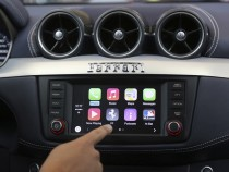 Apple's Stephen Chick displays the CarPlay program at the Worldwide Developers Conference in San Francisco.