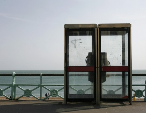 BT telephone boxes are seen on the seafront in Brighton, southern England