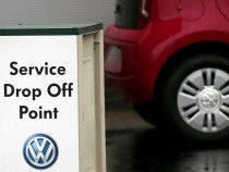 A service drop off point sign is seen outside a Volkswagen dealership in London