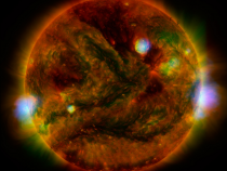 Flaring, active regions of the sun are highlighted in this NASA handout satellite image combining observations...