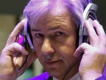 Berlin Mayor Klaus Wowereit wears headphones during his tour of IFA consumer electronics fair in Berlin...