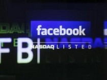 The Facebook logo is seen on a screen inside at the Nasdaq Marketsite in New York May 18, 2012.