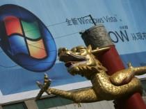 A dragon sculpture is seen near a billboard of Microsoft Vista as Bill Gates visits China April 21, 2007 in Shenyang of Liaoning Province, China.