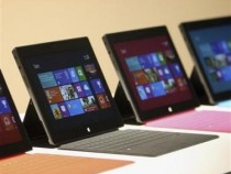 New Surface tablet computers with keyboards are displayed at its unveiling by Microsoft in Los Angeles, California, June 18, 2012.