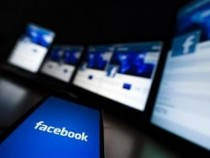 The loading screen of the Facebook application on a mobile phone is seen in this photo illustration taken in Lavigny May 16, 2012.