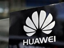 A Huawei logo is seen above the company's exhibition pavilion during the CommunicAsia information and communications technology trade show in Singapore June 19, 2012.