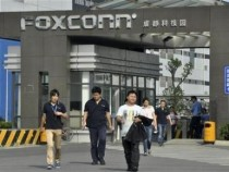 Workers walk out of the entrance to a Foxconn factory in Chengdu, Sichuan province July 4, 2012.