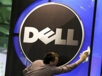 A man wipes the logo of the Dell IT firm at the CeBIT exhibition centre in Hannover. February 28, 2010