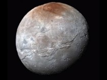 Source Of Mysterious Red Spot On Pluto's Moon Revealed
