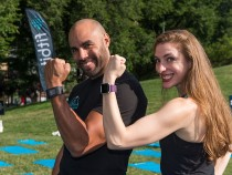 Trainers wearing fitness trackers