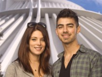 LAKE BUENA VISTA, FL - DECEMBER 29: In this handout photo provided by Disney, 'Twilight' star Ashley Greene (L) poses with actor/singer Joe Jonas of the pop-rock trio 'Jonas Brothers,' in front of Space Mountain at the Magic Kingdom on December 29, 2010 i