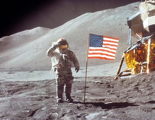 Astronaut David Scott Salutes by U.S. Flag