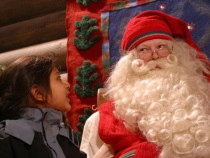 Kiasha Vekaria gazes at Santa Claus