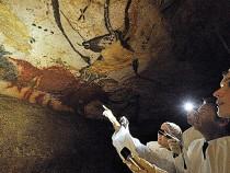 Nicolas Sarkozy Looks at Cave Paintings