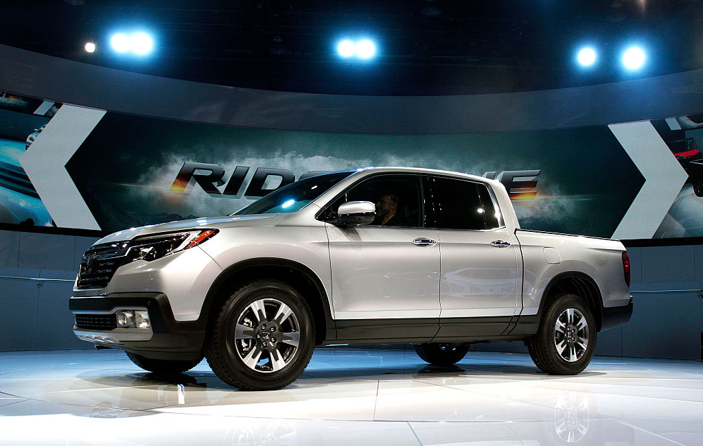 Car Makers Reveal New Models At N. American International Auto Show In Detroit