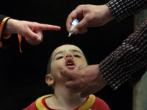 Afghan Health Workers Give Polio Vaccine