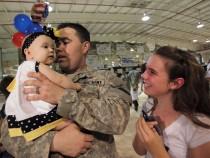 A U.S. soldier hugs his baby daughter