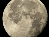International Space Station Flies Above The Full Moon