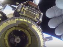 UFO Hunters Cry Cover Up As Astronaut Covers Camera With Hand As Light Flashes By ISS