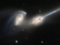 Pair Of Galaxies Engaged In A Celestial Dance Of Cat And Mouse Or In This Case Mouse