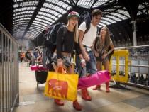 Festival Ticket Holders Board Trains To Take Them To Glastonbury