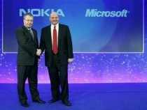 Nokia chief executive Stephen Elop (L) welcomes Microsoft chief executive Steve Ballmer with a handshake at a Nokia event in London February 11, 2011.