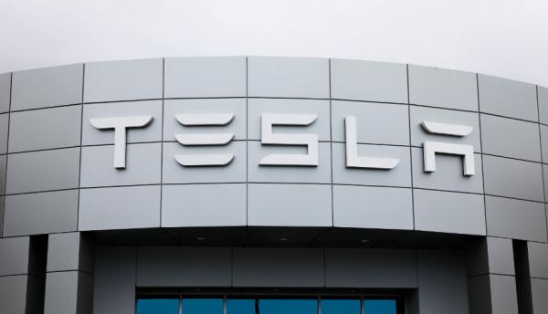 A Tesla service center is shown in Costa Mesa, California