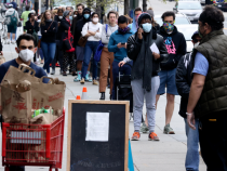 Shoppers keep a social distance outside a grocery store in Washington