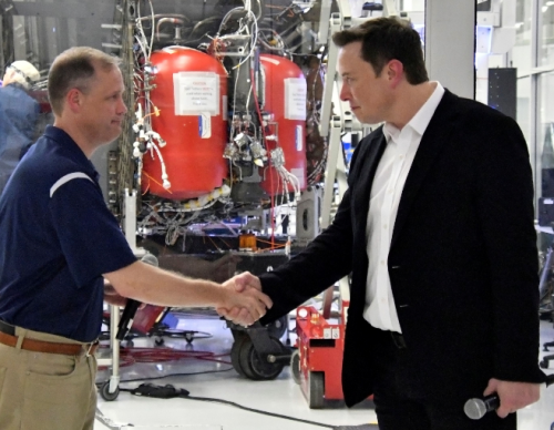 FILE PHOTO: NASA Administrator Jim Bridenstine and SpaceX Chief Engineer Elon Musk shake hands after a tour of SpaceX headquarters in Hawthorne