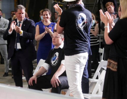 Musk receives a standing ovation during remarks after the launch of a SpaceX Falcon 9 rocket and Crew Dragon spacecraft from NASA's Kennedy Space Center in Cape Canaveral, Florida