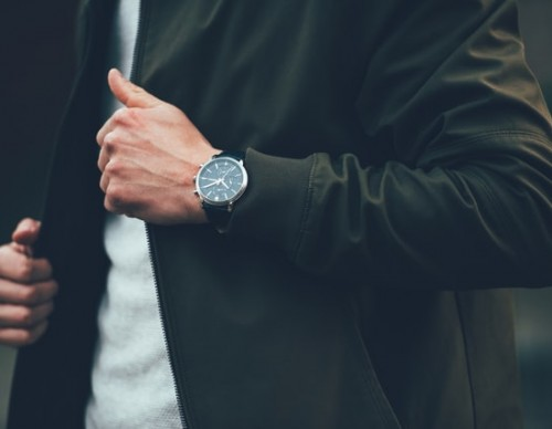 Well-dressed man with a watch
