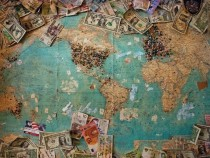 Map of the world with different currencies on it