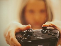 Woman with a video game controller