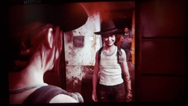 The Last of Us Part 2 Ellie making faces in the mirror while Joel watches her