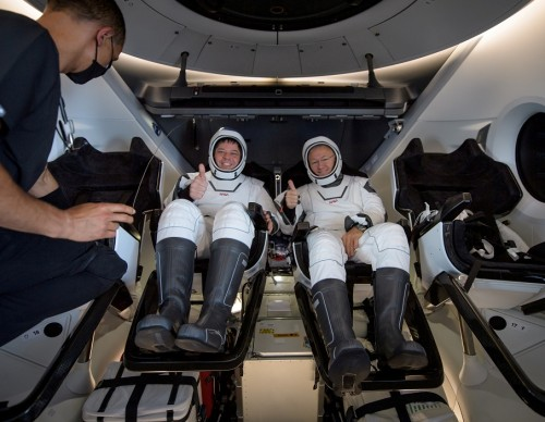NASA astronauts Robert Behnken and Douglas Hurley inside SpaceX Crew Dragon Endeavour spacecraft onboard SpaceX GO Navigator recovery ship shortly after having landed in Gulf of Mexico off coast of Pensacola, Florida