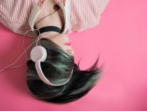 girl listening to podcast