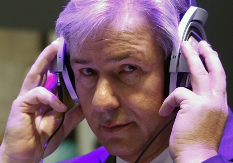 Berlin Mayor Klaus Wowereit wears headphones during his tour of IFA consumer electronics fair in Berlin...