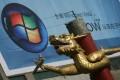A dragon sculpture is seen near a billboard of Microsoft Vista as Bill Gates visits China April 21, 2007 in Shenyang of Liaoning Province, China.