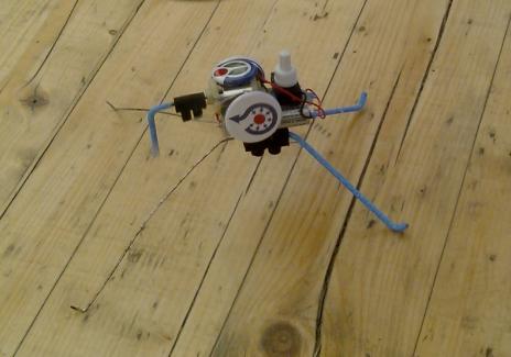 A robot traversing a wooden plank