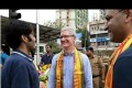 Apple CEO Tim Cook interacts with people in India during his recent visit to the country.