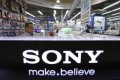 A man looks at Sony Corp's products displayed at an electronics store in Tokyo August 2, 2012.