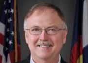 Just hours before Colorado Gov. John W. Hickenlooper signed three new gun control laws, his Department of Corrections Executive Director Tom Clements was shot and killed in his home.