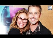 Brad Pitt was radiant as he posed with friend Julia Roberts and was seen for the first time in public after his split away from Angelina Jolie.