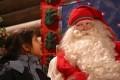 Kiasha Vekaria gazes at Santa Claus