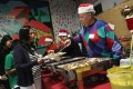 Immigrant Families Attend Christmas Party At Migrant Community Center