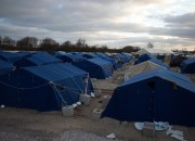 Flu cases in the Aegean island increases as migrants have to deal with limited space and shelter. Public officials struggle with the situation as they face an expected cold snap that might further worsen the problem.