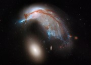 The Hubble Space Telescope has taken a new photo of two galaxies colliding, and they look strangely like a bird watching an egg.