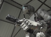The Russian Terminator robot is shown to be able to shoot guns with both hands. It can also drive a car and do press-ups, making people nervous despite Putin's assurance that the violent exercises are just part of the machine's decision making and coordination training.