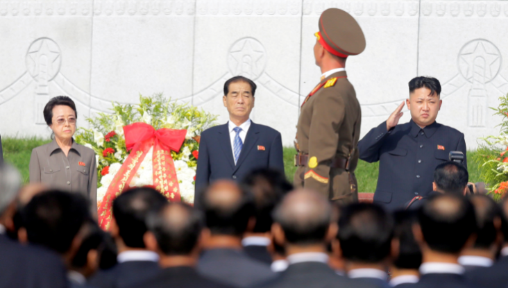 FILE PHOTO: North Korean leader Kim Jong Un salutes as an honour guard march past as he and his aunt Kim Kyong Hui, Premier Pak Pong Ju attend the opening ceremony of the Cemetery of Fallen Fighters of the Korean People's Army (KPA) in Pyongyang